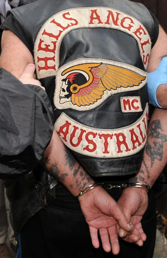 Victoria Police arrest a senior Hells Angels member in 2012, seizing a handgun, cannabis and white powder, were also seized. Picture: Julian Smith.