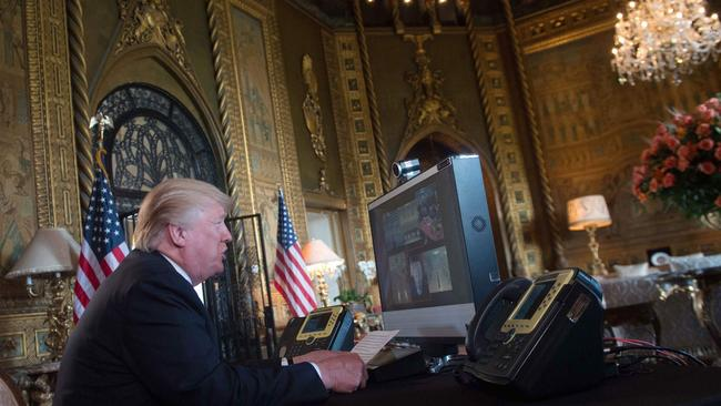 Mr Trump thanks members of the US military via video teleconference on Thanksgiving Day, November 23, 2017 from his residence in Mar-a-Lago in Florida. Picture: AFP/Nicholas Kamn
