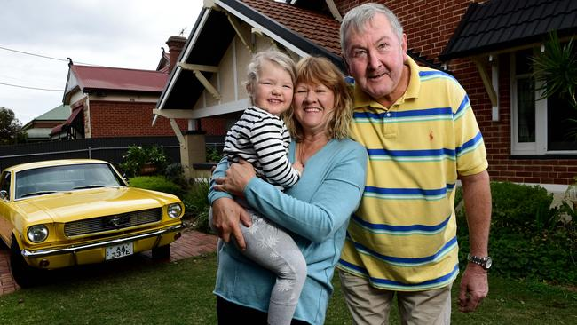 Damian and Debra Lynch, pictured with their 3 year old granddaughter Mabel McHenry, have just bought in the state's top-performing suburb Largs Bay. Picture Mark Brake