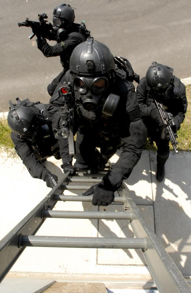 Rapid response ... Australian Special Forces preparing to storm a building in a training exercise. Source: Defence