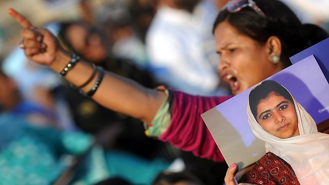 "A Pakistani female supporter of a political party Muttahida Quami Movement (MQM) shouts slogans during a protest procession against the assassination attempt by Taliban on child activist Malala Yousafzai in Karachi on October 14, 2012. A Pakistani schoolgirl Malala Yousafzai shot in the head by the Taliban because she campaigned for the right to education is making ""slow and steady progress"" in her recovery, the military said. AFP PHOTO / RIZWAN TABASSUM"