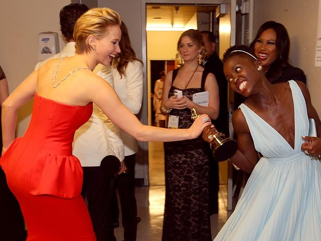 Jennifer Lawrence and Lupita Nyong'o backstage during the Oscars.