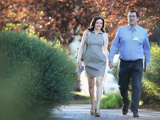 Facebook COO Sheryl Sandberg with her husband, Survey Monkey chief Dave Goldberg.
