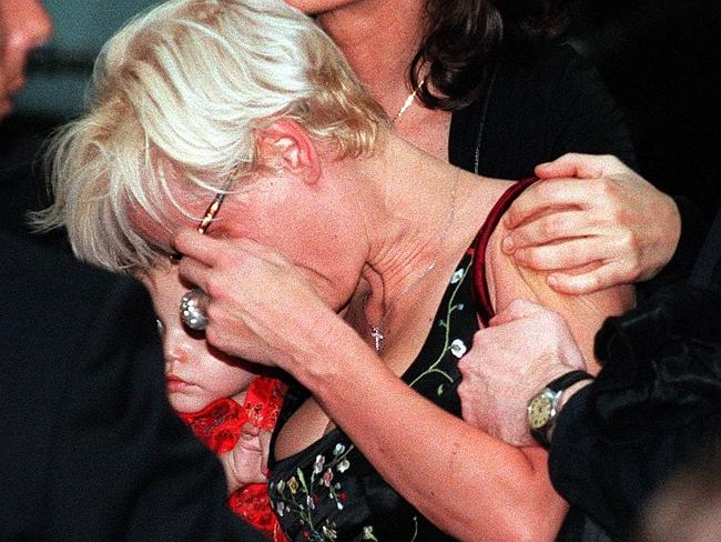 Paula Yates with daughter Tiger Lily, leaves funeral of her late partner Michael Hutchence.