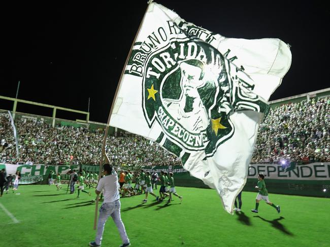 A fan pays tribute to the players of Brazilian team Chapecoense Real at the club's Arena Conda stadium