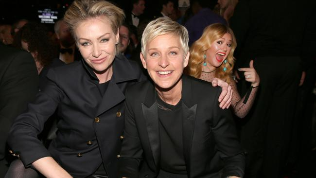 Gay hate... Actress Portia de Rossi (L) and comedienne Ellen DeGeneres attend the 55th Annual Grammy Awards in LA. Picture: Getty