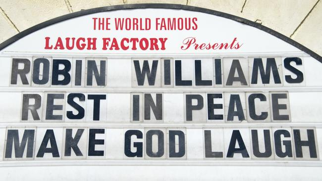 A marquee message at the Laugh Factory comedy club in Hollywood pays tribute to the late Robin Williams. Picture: AFP/Robyn Beck