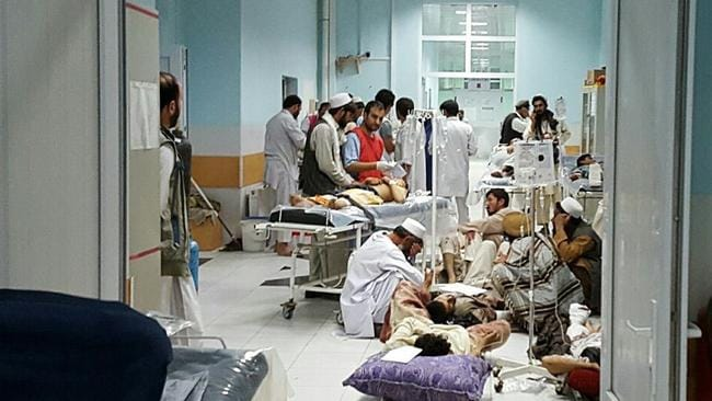 MSF medical personnel treat civilians injured following the US air strike. Picture: AFP Photo / MSF.