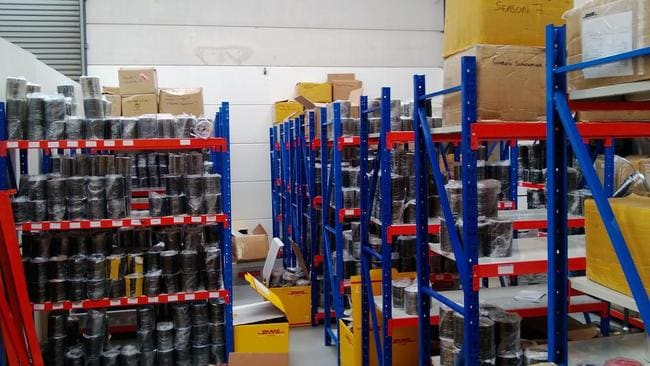 The massive illegal counterfeit DVD operation was hidden in several storage facilities in western Sydney including this Kings Park warehouse. Picture: NSW Police.