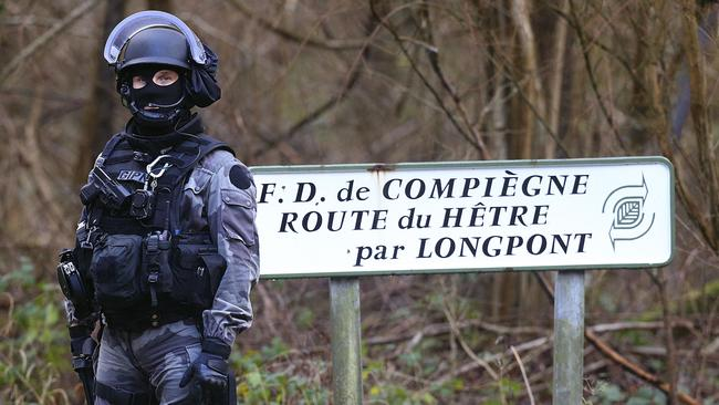 A member of GIPN, (French National Police Intervention Groups) is pictured in Corcy, near Villers-Cotterets, northeast of Paris. Picture: Francois Nascim