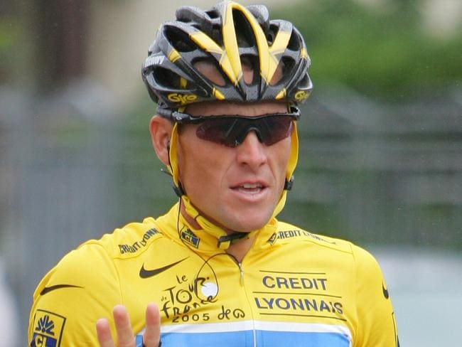 Doping cheat ... Lance Armstrong signals seven for his seventh straight win in the 2005 Tour de France. His victories have been stripped from him after he confessed to doping. Picture: AP