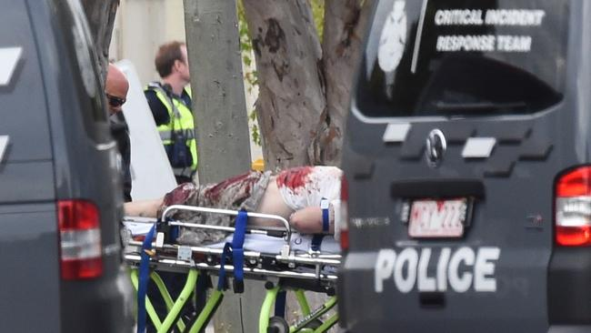 The man known as Trevor is wheeled from the Frankston house. Picture: Nicole Garmston.