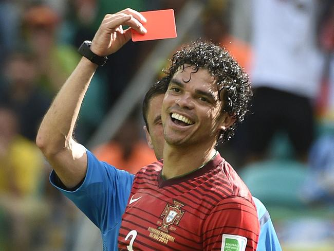 Portugal's defender Pepe (front) receives the red card from Serbian referee Milorad Mazic.
