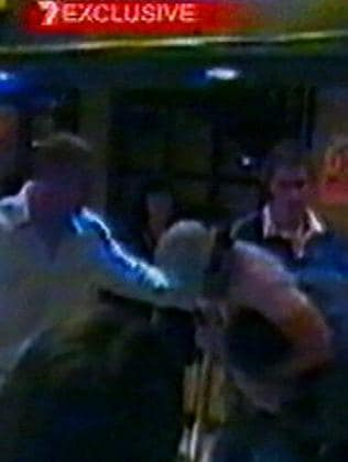 Headlock ... CCTV footage of Brendan Fevola attacking a barman in Dublin. Picture: Channel 7 News
