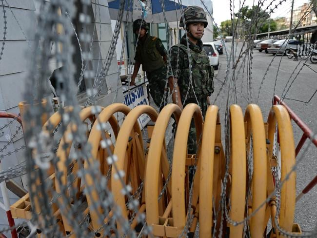 Military coup ... Thai soldiers stand guard at a roadblock outside the Defence Ministry building after the coup. Picture: AFP