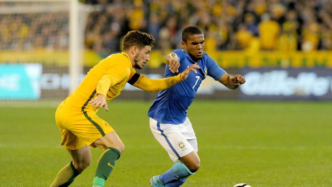 Mathew Leckie of Australia and Douglas Costa of Brazil contest for the ball