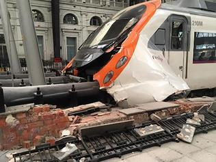 "A picture taken on July 28, 2017 and obtained from the Instagram account ""Ungatodecheshire"" shows a commuter train which slammed into the end of the platform during the morning rush hour at Francia station in the Spanish city of Barcelona. Eighteen people were injured, one of them seriously, and about 30 others were examined by medics, a spokesman for the civil protection services said. / AFP PHOTO / - / NO ARCHIVES"