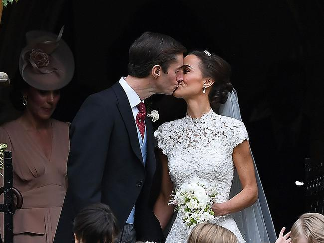 Pippa Middleton kisses her new husband James Matthews. Picture: AFP
