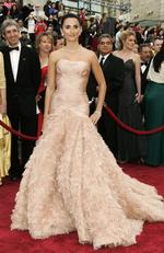 Spanish actress Penélope Cruz was lighter than a feather wearing blushing pink Versace at the 2007 Oscars. Picture: Getty