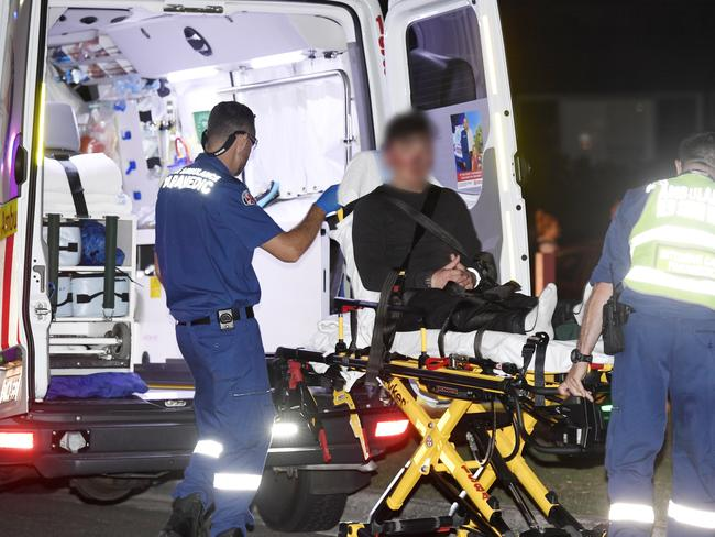 One of the teens, who cannot be identified, being treated by paramedics. Picture: Gordon McComiskie