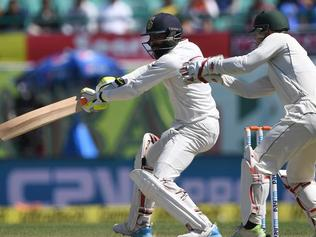 Australia's wicketkeeper Matthew Wade (R) watches as India's Ravindra Jadeja plays a shot during the third day of the fourth and last Test cricket match between India and Australia at The Himachal Pradesh Cricket Association Stadium in Dharamsala on March 27, 2017. ----IMAGE RESTRICTED TO EDITORIAL USE - STRICTLY NO COMMERCIAL USE----- / GETTYOUT---- / AFP PHOTO / PRAKASH SINGH / ----IMAGE RESTRICTED TO EDITORIAL USE - STRICTLY NO COMMERCIAL USE----- / GETTYOUT