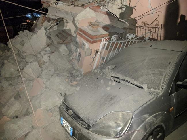 A car amid debris following an earthquake in Casamicciola on the Italian resort island of Ischia. Picture: @percy80 via AP