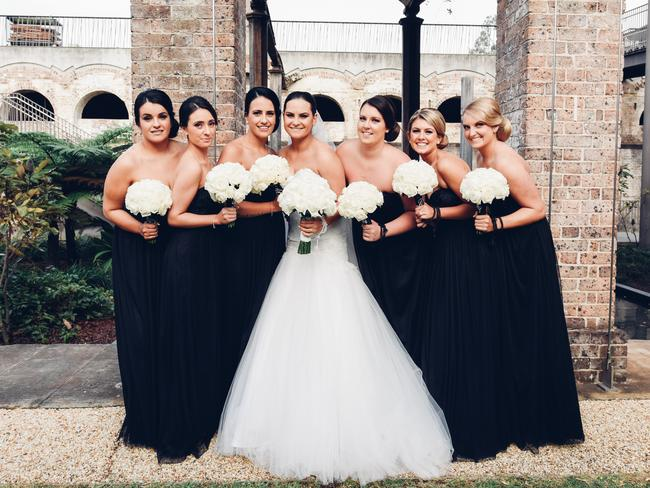 Stephanie with her bridesmaids, who all wore black — the theme colour for the wedding.
