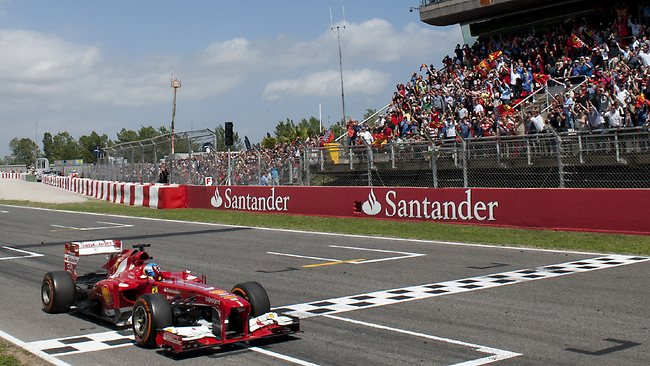 Fernando Alonso crosses the finish line to claim victory in the Spanish Grand Prix.