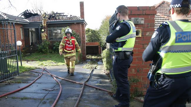 Police and firefighters at the scene of the house fire. Picture: Hamish Blair