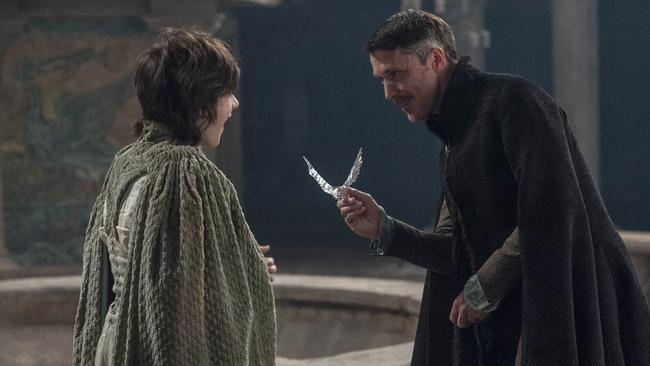 Scheming Littlefinger ... tells Robyn Arryn (Lino Facioli) it's time to man up.