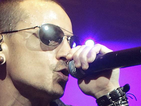 FILE - In this May 16, 2015 file photo, Chester Bennington, left, performs during the MMRBQ Music Festival 2015 at the Susquehanna Bank Center in Camden, N.J. The Los Angeles County coroner says Bennington, who sold millions of albums with a unique mix of rock, hip-hop and rap, has died in his home near Los Angeles. He was 41. Coroner spokesman Brian Elias says they are investigating Bennington's death as an apparent suicide but no additional details are available. (Photo by Owen Sweeney/Invision/AP, File)