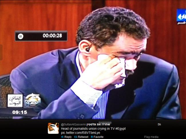 Egypt: Image of a teary head of journalists union crying in TV, tweeted by user @SultanAlQassemi