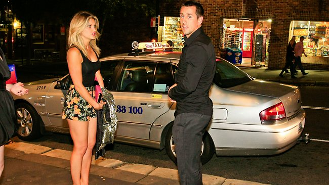 US singer Ashley Roberts, formerly of girl band Pussycat Dolls, with Sydney Roosters NRL player Mitchell Pearce spotted leaving Bar 100 together at The Rocks in Sydney on 28/04/2012.