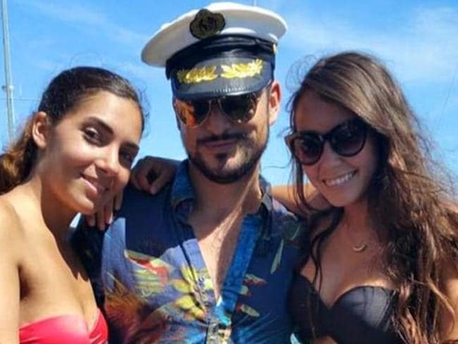 Sydney pick-up artist Denny Jones (pictured with two models) bought six properties in four years now worth $3 million. Picture: Facebook