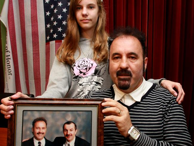 This image of Paul Gyulavary and his daughter Olivia was taken on the 10 year anniversary of 9/11 in 2011. The photo they are holding shows Paul's brother Peter, who is on the right. Peter died in the World Trade Center.