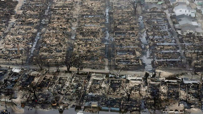 This aerial photo shows burned-out homes in the Breezy Point section of the Queens borough New York. Picture: AP Photo/Mike Groll