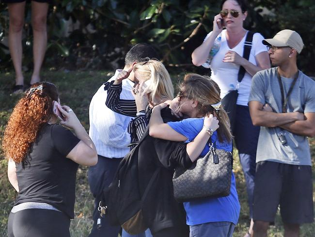 Anxious family members wait for news as the school remained in lockdown. Picture: Wilfredo Lee/AP