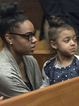 Shayanna Jenkins Hernandez, fiancee of former New England Patriots tight end Aaron Hernandez, sits in the courtroom with the couple's daughter during jury deliberations. Picture: AP
