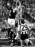 John Nicholls takes a great mark over the pack in the 1970 Grand Final.