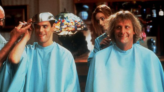 Jim Carrey as Lloyd Christmas and Jeff Daniels as Harry Dunne in Dumb And Dumber.
