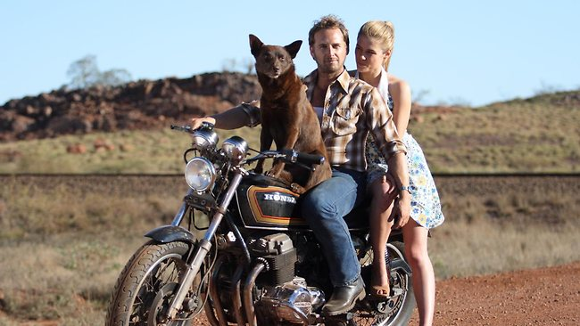 Actors Rachael Taylor, Josh Lucas and dog Koko in a scene from 2011 film 'Red Dog'. Picture: Roadshow