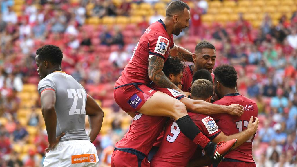 Queensland Reds celebrate after scoring a try during their win over the Southern Kings.