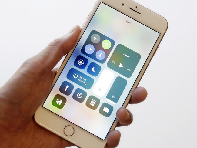 In this Sept. 15, 2017, photo, the iOS 11 control center is displayed on the iPhone 8 Plus in New York. The control center offers easy access to the flashlight and other tools with a swipe up from the bottom. It got separated into multiple pages last year to increase the options available, but the extra swipes got annoying. With iOS 11, it's back to a single page. (AP Photo/Mark Lennihan)