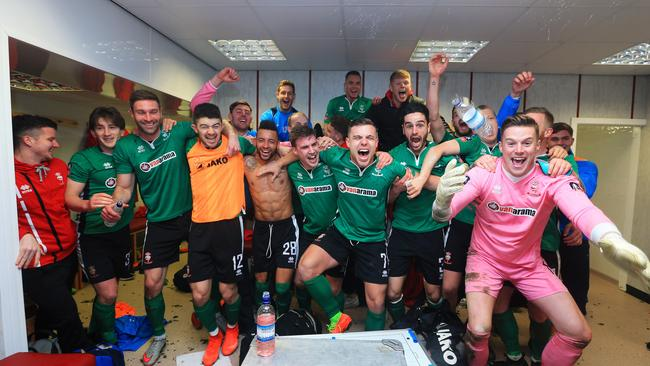 The Lincoln City team celebrate their win in the changing room. Lincoln stun Burnley, Millwall disappointed Leicester, Manchester Town draw, Chelsea win Lincoln stun Burnley, Millwall disappointed Leicester, Manchester Town draw, Chelsea win d7523b476c4dbf7b36e3180cd89305bd