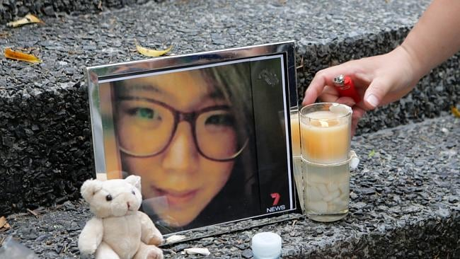 Brandon Lee made a framed photo of Eunji Ban and played a song on his guitar for her near the place her body was found . Picture: Tim Marsden