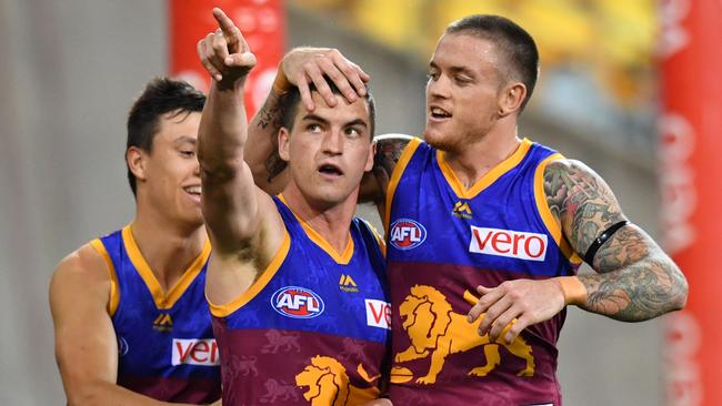 Tom Rockliff celebrates one of his three goals. Picture: AAP