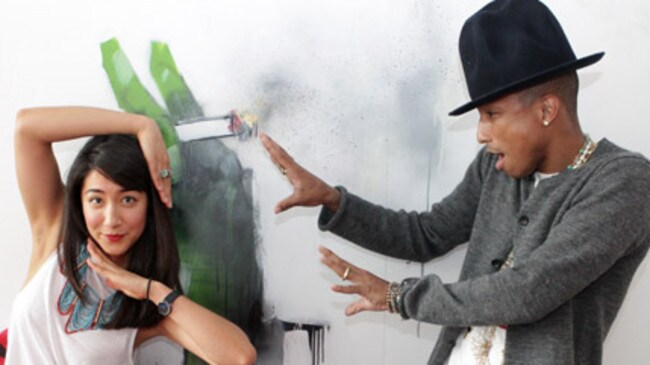Pharrell Williams at Triple J with Lister's work.