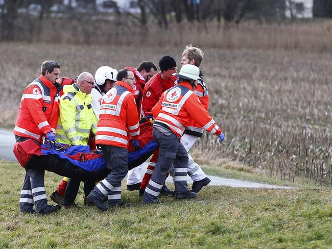 Fatalities ... rescue personnel carry an injured person near the site where two trains collided head-on near Bad Aibling, southern Germany. Picture: AP Photo/Matthias Schrader