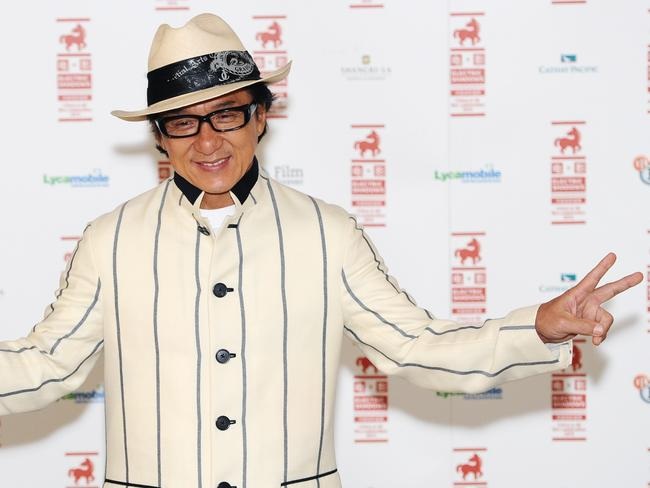 High profile ... Jackie Chan has taken part in Chinese government meetings and often appears on state-run TV.
