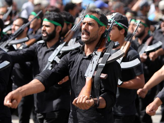 Taking up arms..Iraqi Shiite fighters parade with their weapons in Baghdad, in a dramatic show of force aimed at Sunni militants who overran swathes of territory in a crisis threatening to rip the country apart.